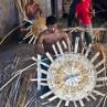 Local artisans creating intricate baskets
